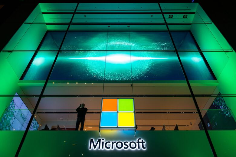 A customer stands near the Microsoft Corp. logo during a Microsoft game console launch event in New York in 2017. (Bloomberg)