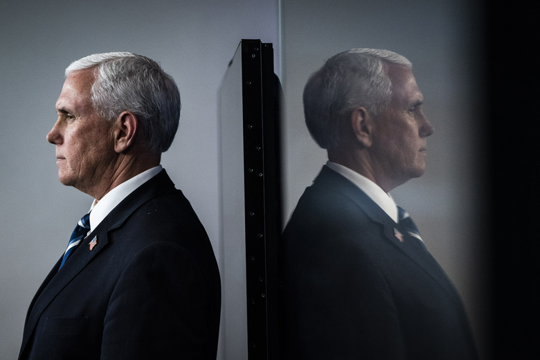 Vice President Pence listens to members of the coronavirus task force at the White House in April. There are no plans for Pence to assume even temporary authority as president, Trump administration officials said Saturday. (Washington Post photo by Jabin Botsford).