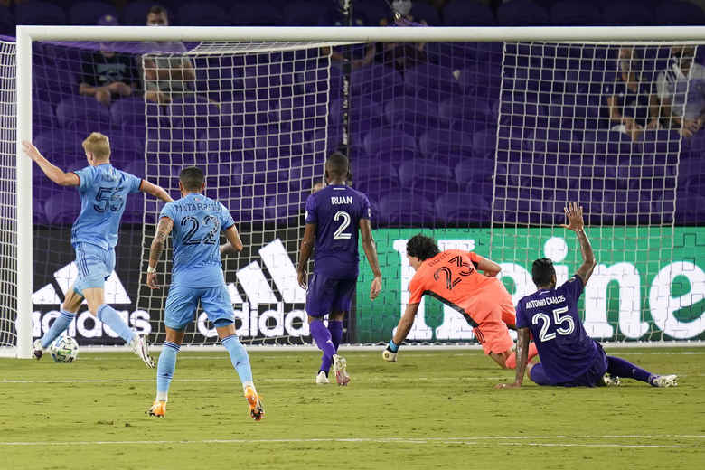 New York City FC midfielder Keaton Parks, far left, score a goal against Orlando City during the first half of an MLS soccer match, Wednesday, Oct. 14, 2020, in Orlando, Fla. (AP Photo/John Raoux)