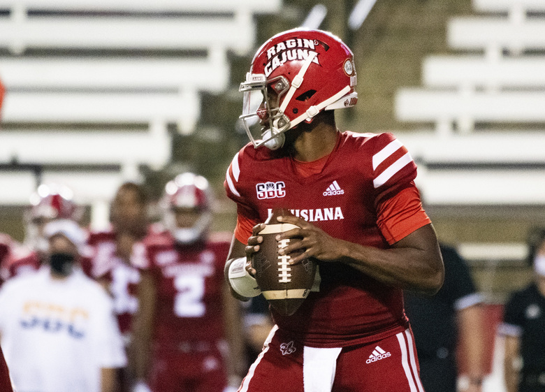 Louisiana-Lafayette quarterback Levi Lewis (1) drops back to attempt a pass during the first half of an NCAA football game against Coastal Carolina in Lafayette, La., Wednesday, Oct. 14, 2020. (AP Photo/Paul Kieu)