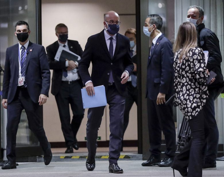 European Council President Charles Michel leaves after a media conference at an EU summit at the European Council building in Brussels, Thursday, Oct. 15, 2020. European Union leaders met in person for the first day of a two-day summit, amid the worsening coronavirus pandemic, to discuss topics ranging from Brexit to climate and relations with Africa. (Olivier Hoslet, Pool via AP)