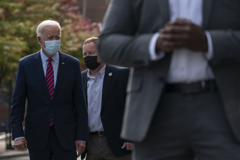 Democratic presidential candidate former Vice President Joe Biden walks to his motorcade vehicle after talking with police officers in Wilmington, Del., on Monday. (Carolyn Kaster / AP Photo)