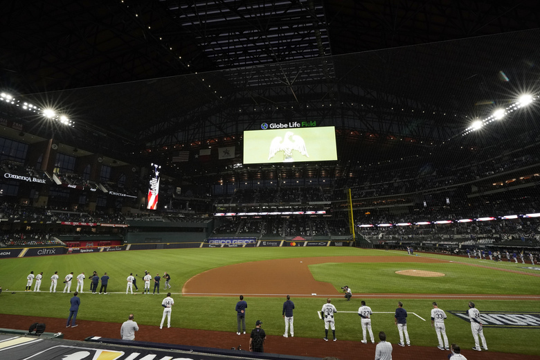 Members of the Tampa Bay Rays stand for the national anthem before Game 3 of the baseball World Series against the Los Angeles Dodgers Friday, Oct. 23, 2020, in Arlington, Texas. (AP Photo/Tony Gutierrez)