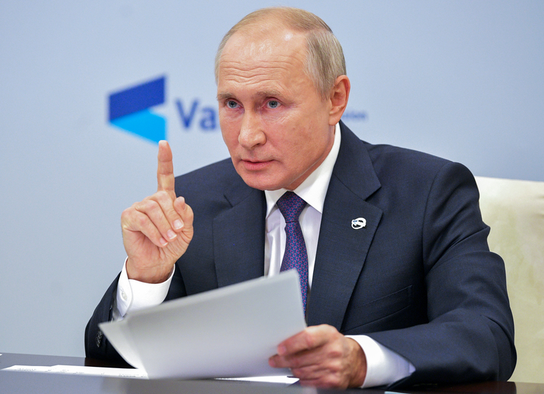 Russian President Vladimir Putin gestures while speaking at the annual meeting of the Valdai Discussion Club via video conference at the Novo-Ogaryovo residence outside Moscow, Russia, Thursday, Oct. 22, 2020. (Alexei Druzhinin, Sputnik, Kremlin Pool Photo via AP)