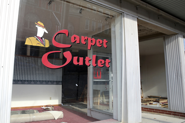 The Carpet Outlet, owned by Howard Eakle is closed as a result of the coronavirus pandemic in West Union, W.Va., Wednesday, Oct. 21, 2020. Eakle closed to retire early at 64 when business dried up with the pandemic. (AP Photo/Kathleen Batten)