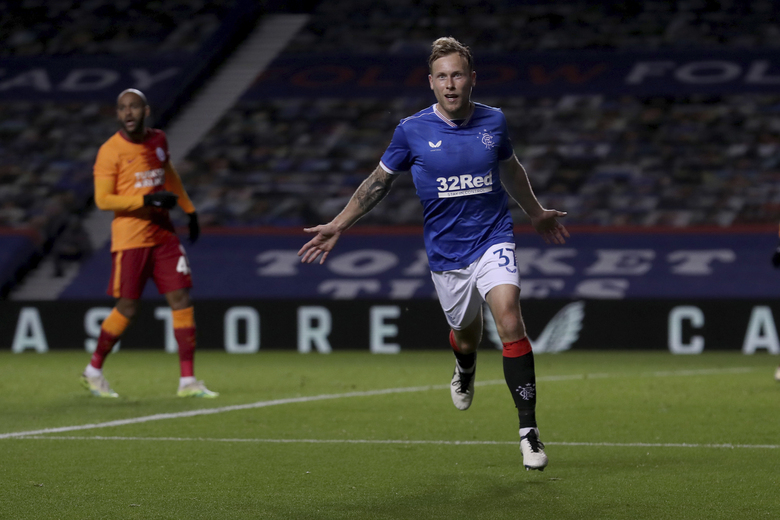 Rangers' Scott Arfield celebrates scoring his side's first goal during the Europa League qualifying play-off soccer match between Rangers and Galatasaray at Ibrox Stadium, in Glasgow, Scotland, Thursday, Oct. 1, 2020. (Ian MacNicol/Pool via AP)