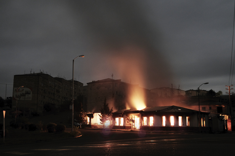 A building of a residential area burns after night shelling by Azerbaijan's artillery during a military conflict in self-proclaimed Republic of Nagorno-Karabakh, Stepanakert, Azerbaijan, early Sunday, Oct. 4, 2020. Armenian officials on Sunday accused Azerbaijan of carrying out strikes on Stepanakert. Azerbaijan's Defense Ministry said Armenian forces were attacking the towns of Terter and Horadiz from Stepanakert. (Areg Balayan/ArmGov PAN Photo via AP)