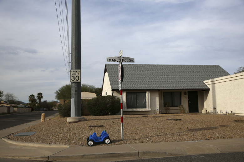 A toy car sits outside a home located near the intersection between the Arizona State Route 101 and the Interstate 17 freeway in Phoenix, Ariz., on March 9, 2020. The AP analyzed the changes in the vote from 2016 to 2018 to demonstrate the shifting battleground. In Phoenix, the average flip zone in Phoenix occurred on average at 670 households per square mile in 2018. It reached into the shopping plazas and office parks and cul-de-sacs where homes had backyards large enough for swimming pools. The flip zone was nearly 1,000 households per square mile in 2016. If measured as a distance from city hall, the flip zone pushed out more than two miles in the span of two years, right to the northern edge of Interstate 101 in Phoenix. Arizona elected a Democrat to the Senate held by Republican for 24 years. (AP Photo/Dario Lopez-MIlls)