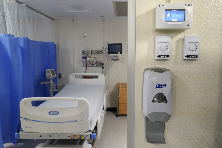 New machinery, right, that helps to turn a regular hospital room into an isolation room is seen at Bellevue Hospital in New York, Wednesday, Oct. 28, 2020. Hospitals in the city's public NYC Health and Hospitals' system have been upgrading their equipment, bracing for a potential resurgence of coronavirus patients, drawing on lessons learned in the spring when the outbreak brought the nation's largest city to its knees. (AP Photo/Seth Wenig)