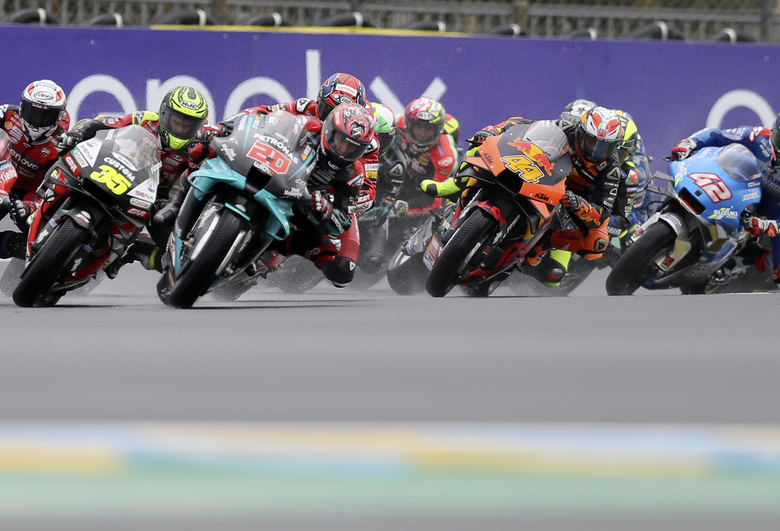 France's rider Fabio Quartararo of the Petronas Yamaha SRT, second left, leads the pack at the start of the MotoGP race of the French Motorcycle Grand Prix at the Le Mans racetrack, in Le Mans, France, Sunday, Oct. 11, 2020. (AP Photo/David Vincent)