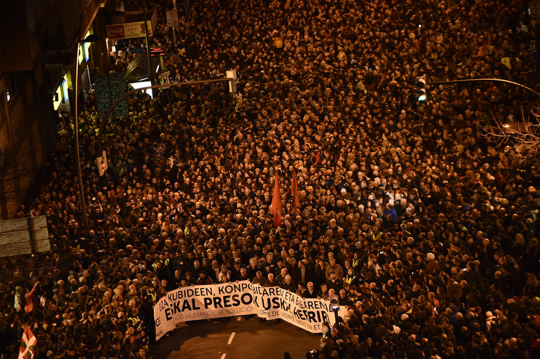 """FILE – In this Jan 9, 2016 file photo, demonstrators hold a banner that reads in Basque language, """"All rights for the Basque prisoners"""", as pro-independence Basque demonstrators demand the return of all prisoners of ETA, the Basque armed terrorist group, to the Basque Country, during a protest in Bilbao, northern Spain. Josu Urrutikoetxea, the last known chief of ETA, the now-extinct Basque separatist militant group, goes on trial Monday Oct. 19, 2020 in Paris for terrorism charges that he deems """"absurd"""" because of his role in ending a conflict that claimed hundreds of lives and terrorized Spain for half a century. (AP Photo/Alvaro Barrientos, file)"""