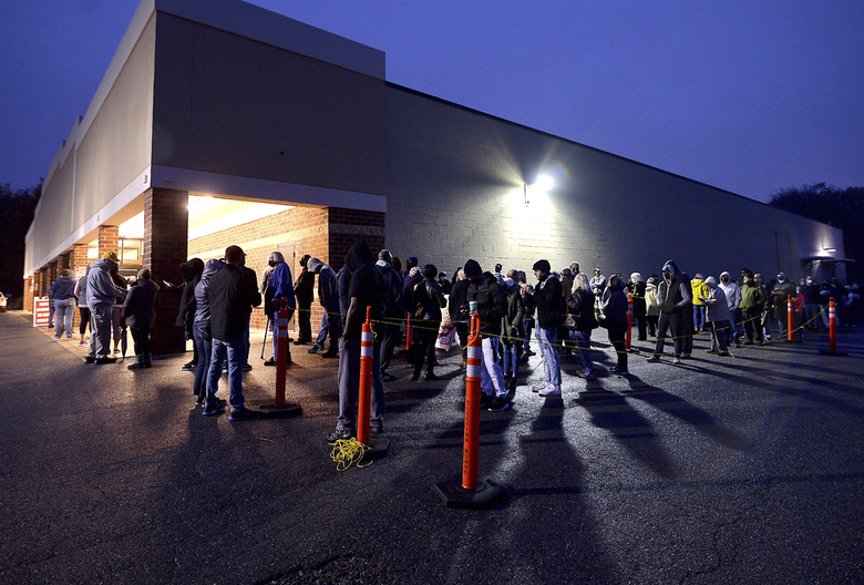 Voters are lined up outside the Washington County Election Center in Hagerstown, Md., Monday morning, Oct. 26, 2020, on the first day of in-person early voting. (Colleen McGrath/The Herald-Mail via AP)