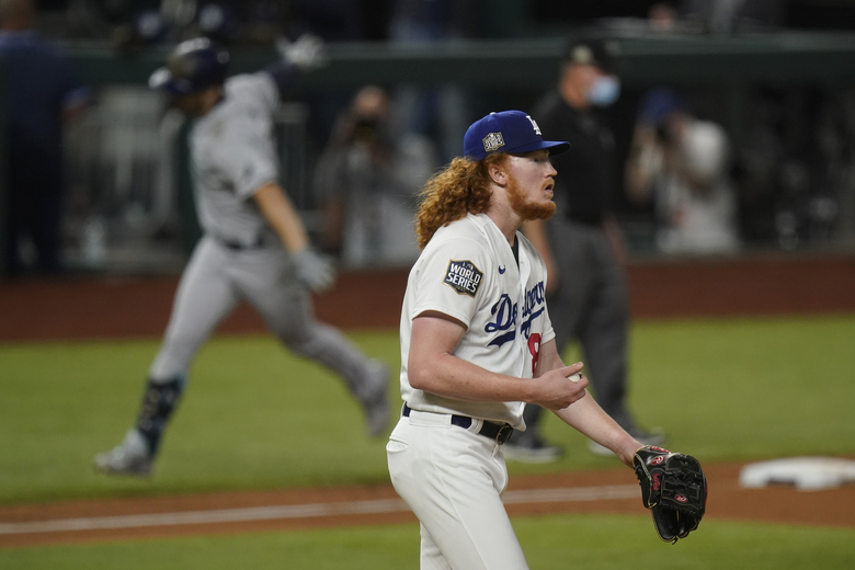 Tampa Bay Rays' Brandon Lowe celebrates a two-run home run off Los Angeles Dodgers starting pitcher Dustin May during the fifth inning in Game 2 of the baseball World Series Wednesday, Oct. 21, 2020, in Arlington, Texas. (AP Photo/Eric Gay)