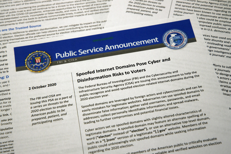 A public service announcement from the FBI and the Department of Homeland Security cybersecurity agency is photographed Tuesday. The government agencies have issued a series of advisories in recent weeks aimed at warning voters about problems that could surface in the election — as well as steps Americans can take to counter the foreign interference threat.  (AP Photo/Jon Elswick)