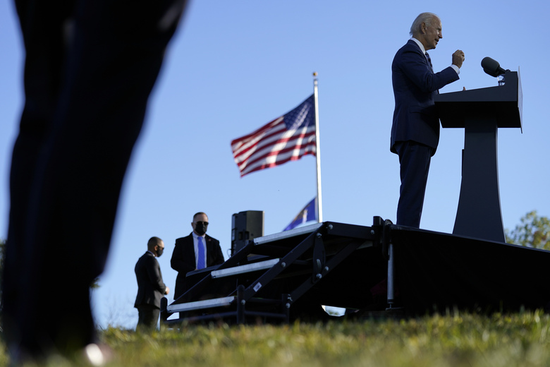As U.S. Secret Service agents watch, Democratic presidential candidate former Vice President Joe Biden speaks at Gettysburg National Military Park in Gettysburg, Pa., Tuesday, Oct. 6, 2020. (AP Photo/Andrew Harnik)