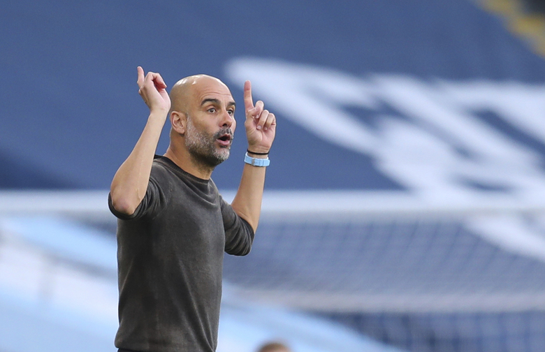 Manchester City's head coach Pep Guardiola gestures to his players from the side lines during the English Premier League soccer match between Manchester City and Leicester City at the Etihad stadium in Manchester, England, Sunday, Sept. 27, 2020. (Catherine Ivill/Pool via AP)