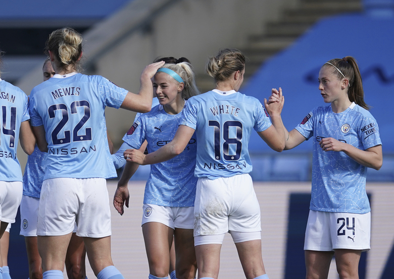 Manchester City's Chloe Kelly, center left, celebrates scoring her sides first goal in the Women's Super League soccer match between Manchester City Women and Tottenham Hotspur Women at the Academy Stadium, Manchester, England, Sunday Oct. 4, 2020. (AP Photo/Dave Thompson)