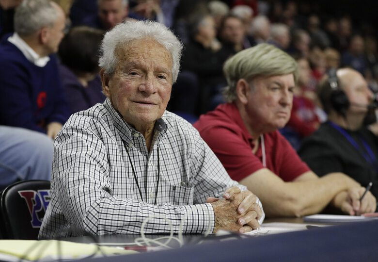 Long-time Associated Press correspondent Jack Scheuer sits courtside watching Penn take on Princeton in an NCAA college basketball game at The Palestra on Saturday, Jan. 4, 2020, in Philadelphia. Scheuer, the go-to guy at courtside, on the field and in the press box, who covered Philadelphia sports from the days of Wilt Chamberlain to Bryce Harper for The Associated Press and other outlets, died Friday, Oct. 16, 2020. He was 88. (Yong Kim/The Philadelphia Inquirer via AP)