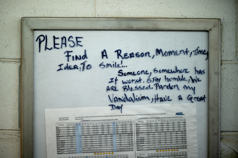 A motivational message is written on a timetable at a Metra train line station in the Auburn Gresham neighborhood in Chicago, Thursday, Aug. 27, 2020. As this agonizing year nears an end, some in Auburn Gresham are looking ahead, with hope. (AP Photo/David Goldman)