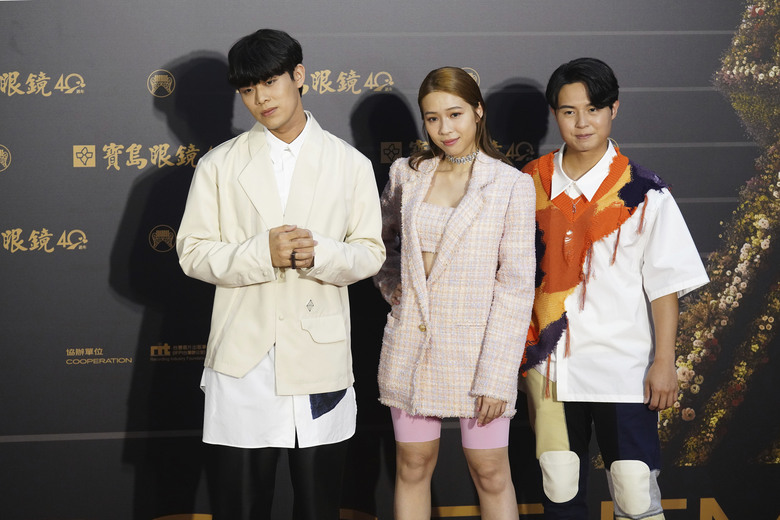"Taiwanese pop group ""Accusefive"" pose as they arrive for the 31th Golden Melody Awards in Taipei, Taiwan, Saturday, Oct. 3, 2020. The awards show, one of the world's biggest Chinese-language pop music annual events was postponed from June to Oct. due to the coronavirus pandemic. (AP Photo/Billy Dai)"