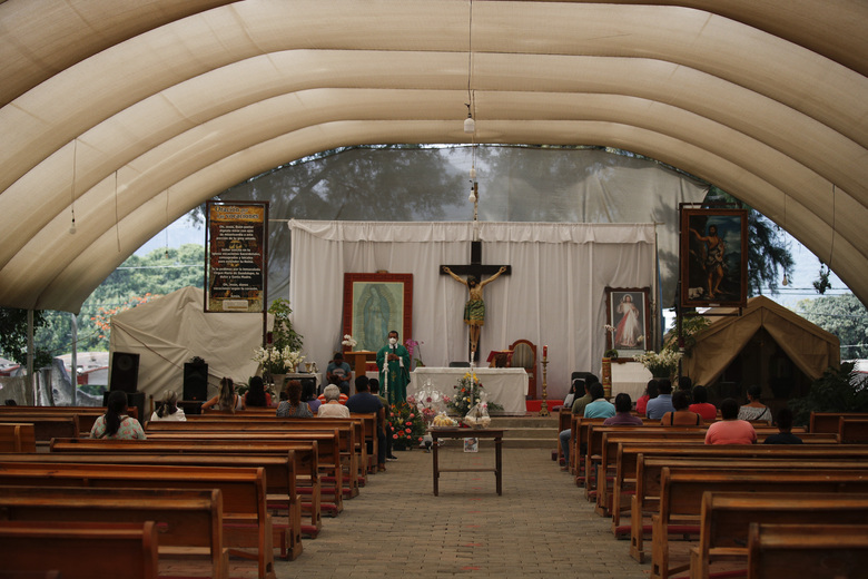 Father Filiberto Arias Araujo leads an afternoon Mass in a temporary outdoor chapel erected outside the former San Juan Bautista Convent, where restoration work is underway following damage in a 2017 earthquake, in Tlayacapan, Morelos State, Mexico, Tuesday, Oct. 13, 2020. Araujo explained the importance of the bells in Mexican village life: that church bells are commonly rung as an alarm in emergencies, or toll to gather townspeople together. (AP Photo/Rebecca Blackwell)