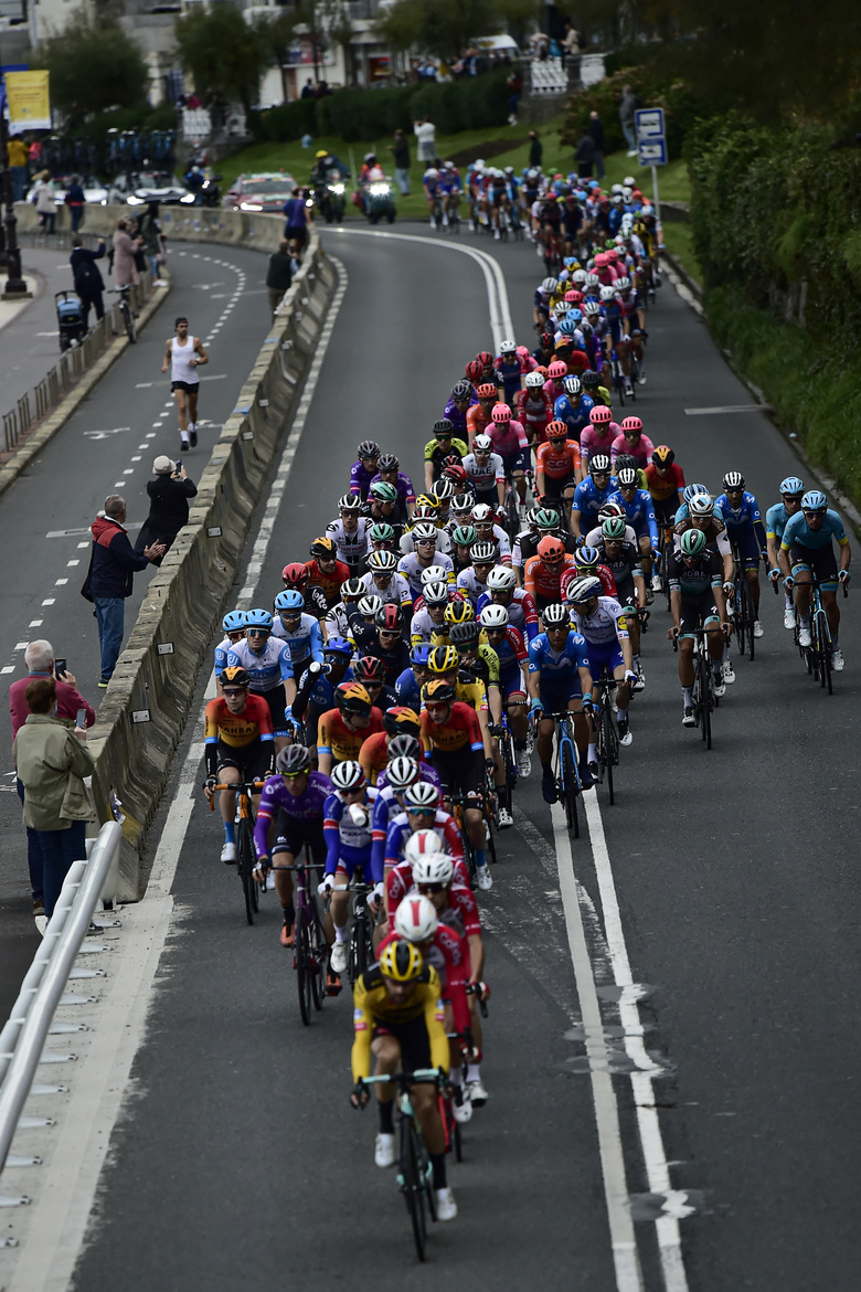 The pack race across a street in San Sebastian at the start of the first stage of La Vuelta between Irun – Arrate.Eibar, 173 km, of the Spanish Vuelta cycling race that finishes in Arrate, northern Spain, Tuesday, Oct. 20, 2020. (AP Photo/Alvaro Barrientos)