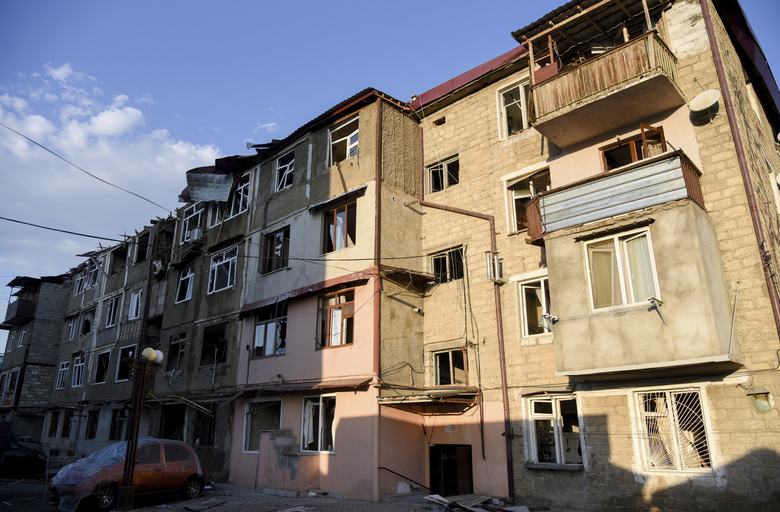 A view of a residential area and cars that were allegedly damaged by shelling during a military conflict in self-proclaimed Republic of Nagorno-Karabakh, Stepanakert, Azerbaijan, Saturday, Oct. 3, 2020. The fighting is the biggest escalation in years in the decades-long dispute over the region, which lies within Azerbaijan but is controlled by local ethnic Armenian forces backed by Armenia. (David Ghahramanyan/NKR InfoCenter PAN Photo via AP)