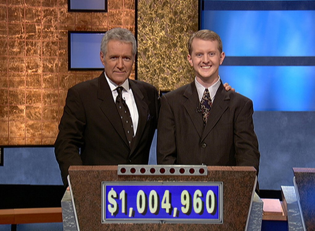 "Longtime ""Jeopardy!"" host Alex Trebek, left, with contestant Ken Jennings in 2004. Jennings on Tuesday was nominated for a Grammy Award for his narration and contributions to the spoken-word album, ""Alex Trebek — The Answer Is …,"" Trebek's memoir. (Jeopardy Productions / AFP / Getty Images)"