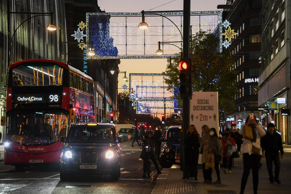 The sun sets Wednesday on Oxford Street in London, as Britain prepares to join large swaths of Europe in a coronavirus lockdown. Pubs, restaurants, hairdressers and shops selling non-essential items will have to close Thursday until at least Dec. 2. (Alberto Pezzali / The Associated Press)