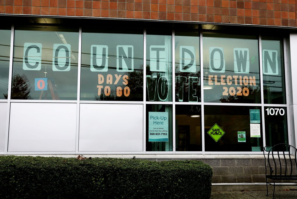"An election countdown sign is set to ""0 days to go"" on Election Day at Monroe Library. (Ken Lambert / The Seattle Times)"