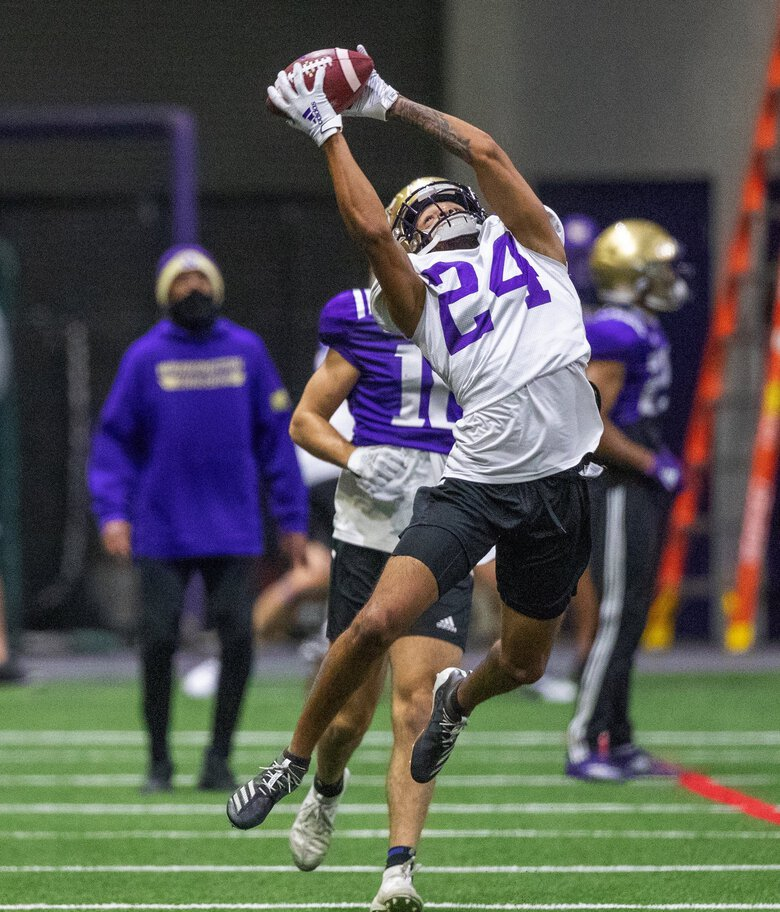 Tailback Kamari Pleasant catches a pass as the University of Washington Huskies practice at the Dempsey Center field on October 23, 2020.  (Mike Siegel / The Seattle Times)