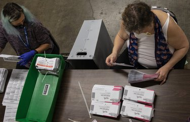 Election workers organize ballots at the Multnomah County Elections Division Tuesday, Nov. 3, 2020 in Portland, Ore. Oregon is the first state in the nation to institute voting by mail and automatic voter registration (AP Photo/Paula Bronstein) ORPB117 ORPB117