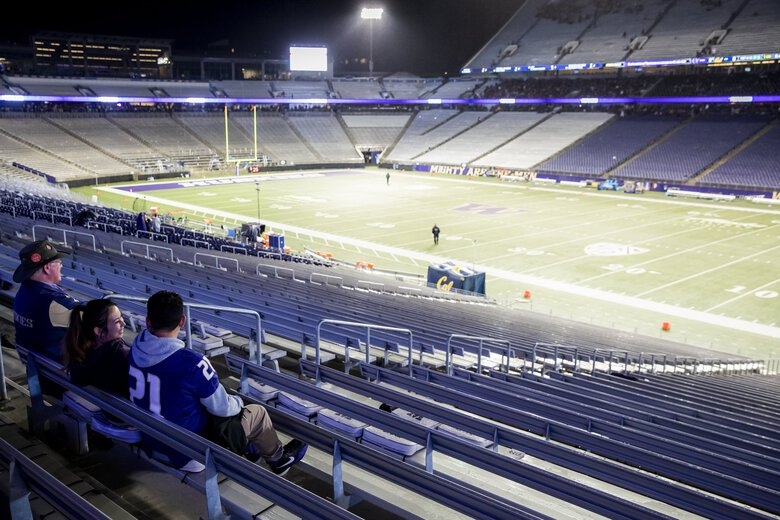 Fans wait out a lightning delay when a thunderstorm rolls through as the University of Washington Huskies take on the California Golden Bears at Husky Stadium in Seattle Saturday September 7, 2019. (Dean Rutz / The Seattle Times)