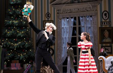"Pacific Northwest Ballet principal dancer Seth Orza as Drosselmeier and PNB School student Zoe Alvarado as Clara in a scene from PNB's ""The Nutcracker,"" choreographed by George Balanchine. PNB is streaming a previous production of its annual holiday show in December."