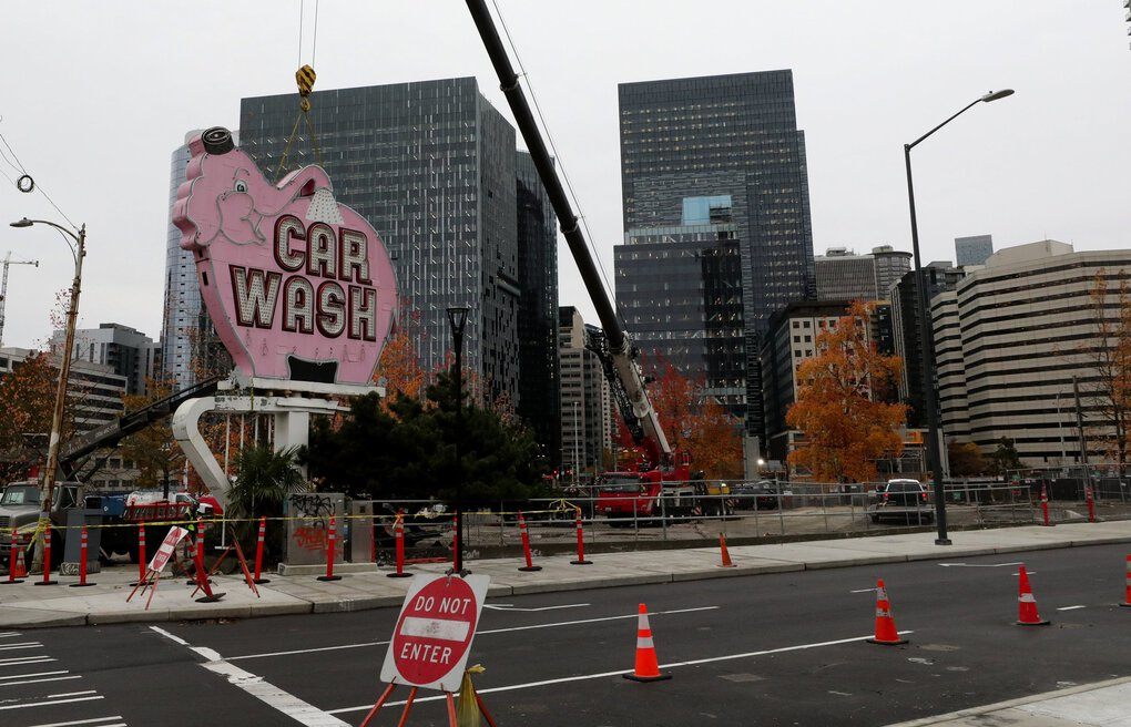 The iconic Elephant Car Wash sign is seen in its last moments Tuesday at Denny Way and Aurora Avenue, where it's stood for 64 years.   (Alan Berner / The Seattle Times)