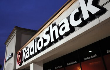 FILE – This Tuesday, Feb. 3, 2015 file photo shows a RadioShack store in Dallas.  RadioShack, the nearly century-old electronics retailer ubiquitous in malls for decades, has been pulled from brink of death — again. It's the most prized name in the basket of retail brands that entrepreneur investors Alex Mehr and Tai Lopez have scooped up for a relative pittance since the coronavirus pandemic landed on U.S. shores.   (AP Photo/Tony Gutierrez, File) NYBZ202 NYBZ202
