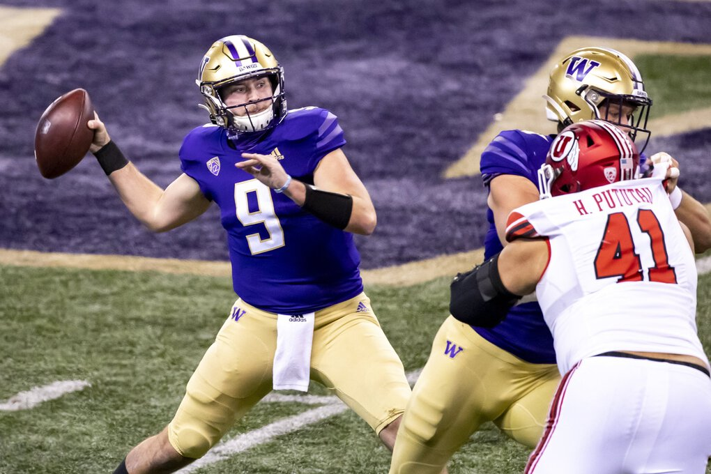 Washington Huskies quarterback Dylan Morris throws a first-quarter interception as the University of Washington Huskies take on the Utah Utes at Husky Stadium in Seattle Saturday November 28, 2020. (Bettina Hansen / The Seattle Times)