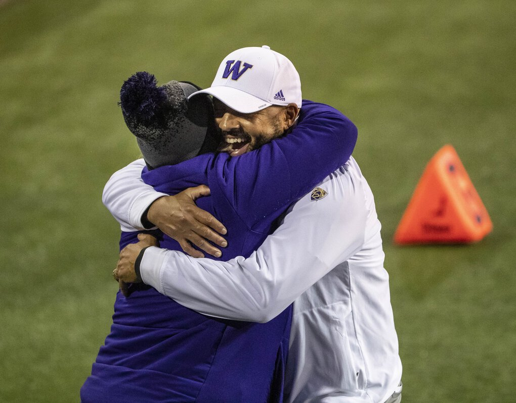 Coach Jimmy Lake hugs athletic director Jen Cohen after Washington defeated Utah 24-21. (Dean Rutz / The Seattle Times)