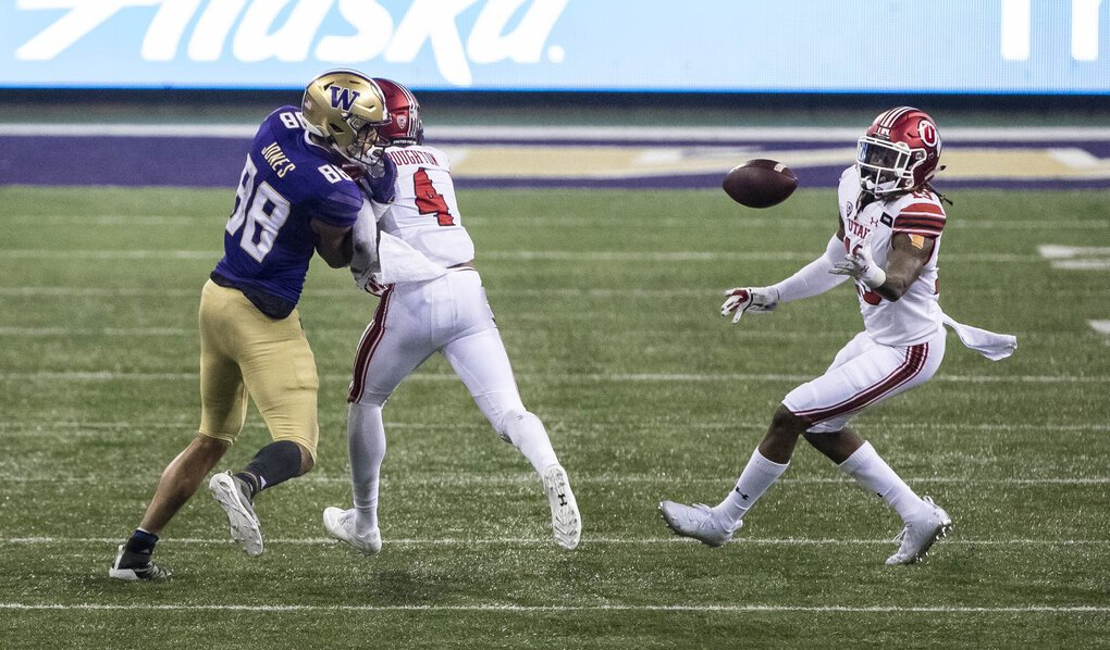 The pass to Washington's Ty Jones bounces off pads and into the hands of Utah's Vonte Davis in the 4th quarter. (Dean Rutz / The Seattle Times)