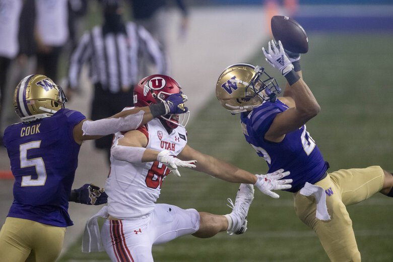 Trent McDuffie pulls in the interception that would seal the win over Utah for Washington. (Dean Rutz / The Seattle Times)