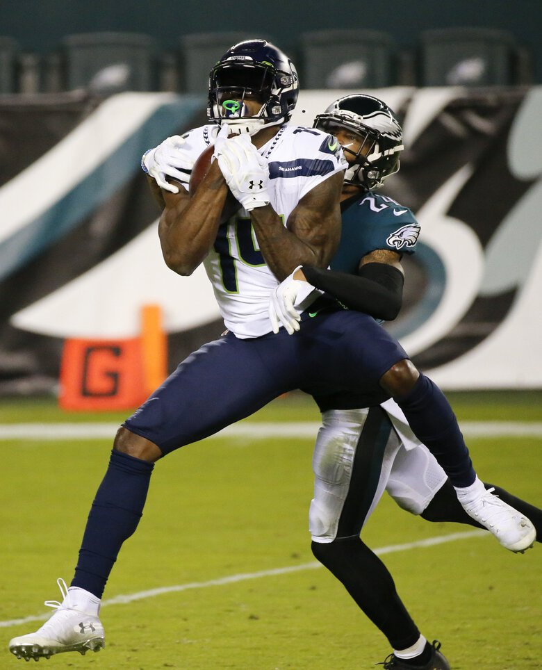 Seattle Seahawks wide receiver DK Metcalf catches the football past Eagles cornerback Darius Slay during the second quarter on Monday, November 30, 2020. (MONICA HERNDON / The Philadelphia Inquirer)