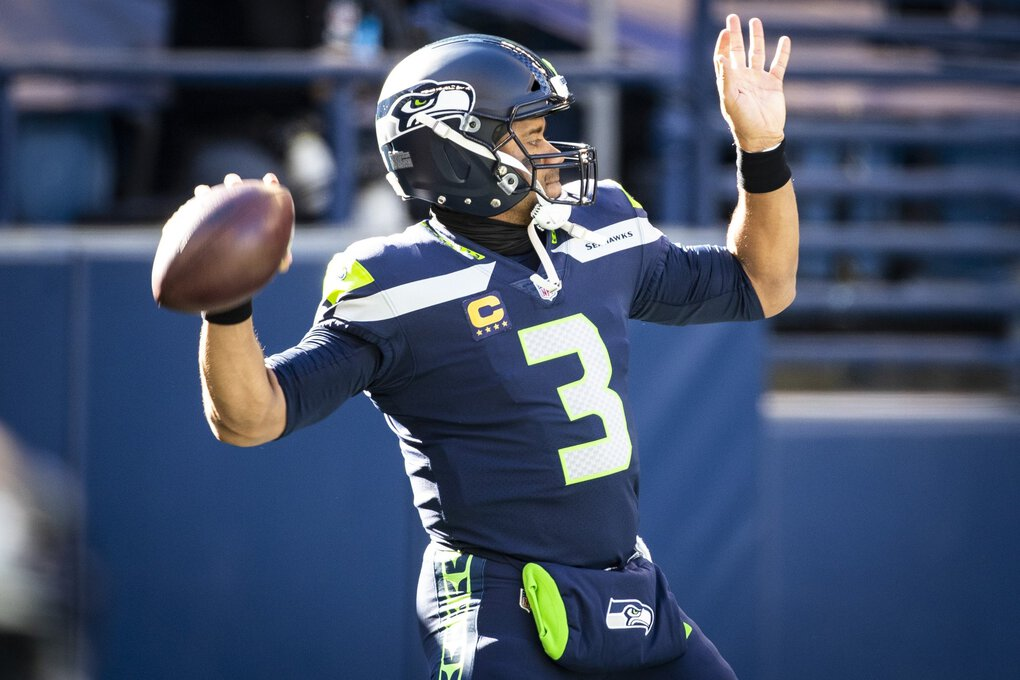 Seahawks quarterback Russell Wilson warms up before the Seattle Seahawks take on the San Francisco 49ers at CenturyLink Field on Sunday.  (Bettina Hansen / The Seattle Times)
