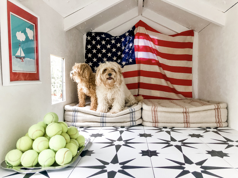 "Jen McDonald's doghouse features a bold back-and-white tile. ""I love rugs,"" the stylist says, ""but having a tiled surface is just smarter with a young family."" (Courtesy of Jen McDonald)"