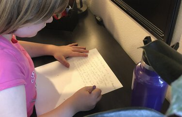 Estelle Ness, a John Rogers Elementary student, works on her second-grade writing assignment during remote learning Thursday, Nov. 19, 2020.