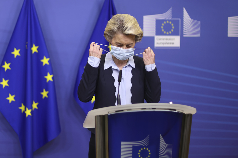 European Commission President Ursula von der Leyen removes her face mask as she arrives to give a statement at the EU headquarters in Brussels, Monday, Nov. 16, 2020. (Kenzo Tribouillard, Pool Photo via AP)