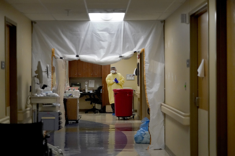 Dr. Shane Wilson stands inside a section of Scotland County Hospital set up to treat COVID-19 patients Tuesday, Nov. 24, 2020, in Memphis, Mo. As the coronavirus spreads in the rural northeast part of the state, doctors at the tiny hospital are already making difficult, often heartbreaking decisions about who they can take in and fear the situation is likely to get worse. (AP Photo/Jeff Roberson)