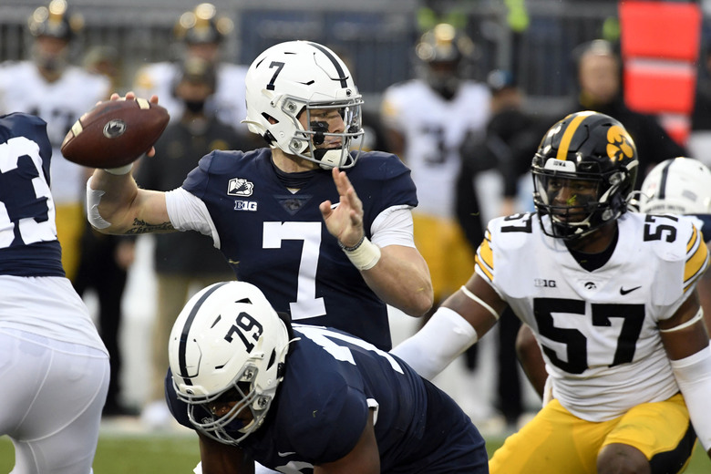 Penn State quarterback Will Levis (7) looks to pass as Iowa defensive lineman Chauncey Golston (57) closes in during the first quarter of an NCAA college football game in State College, Pa., on Saturday, Nov. 21, 2020. (AP Photo/Barry Reeger)