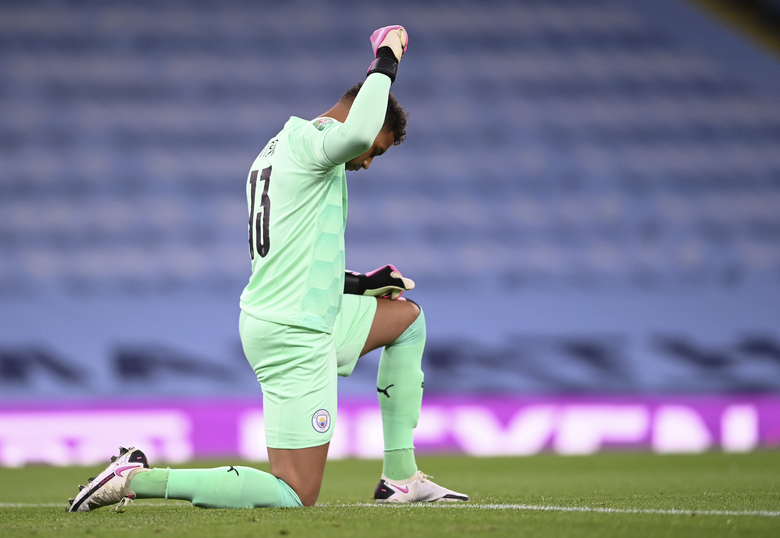 Manchester City's goalkeeper Zack Steffen gestures prior to the start of the English League Cup third round soccer match between Manchester City and Bournemouth at the City of Manchester Stadium in Manchester, England, Thursday, Sept. 24, 2020.(Laurence Griffiths/Pool via AP)
