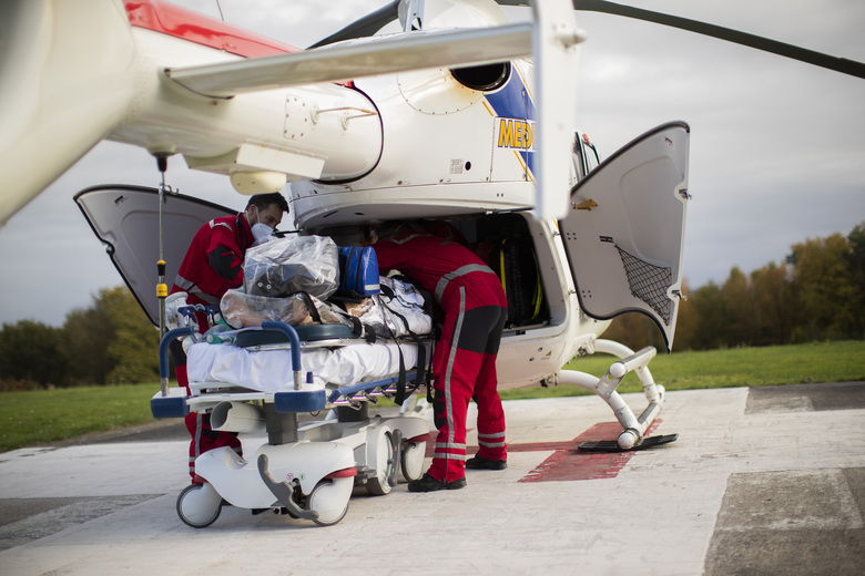 Medical personnel begin to load a coronavirus patient into a helicopter as they prepare to transfer the patient from the COVID-19 intensive care unit of the CHU Liege hospital to another hospital in Germany, in Liege, Belgium, Tuesday, Nov. 3 , 2020. (AP Photo/Francisco Seco)