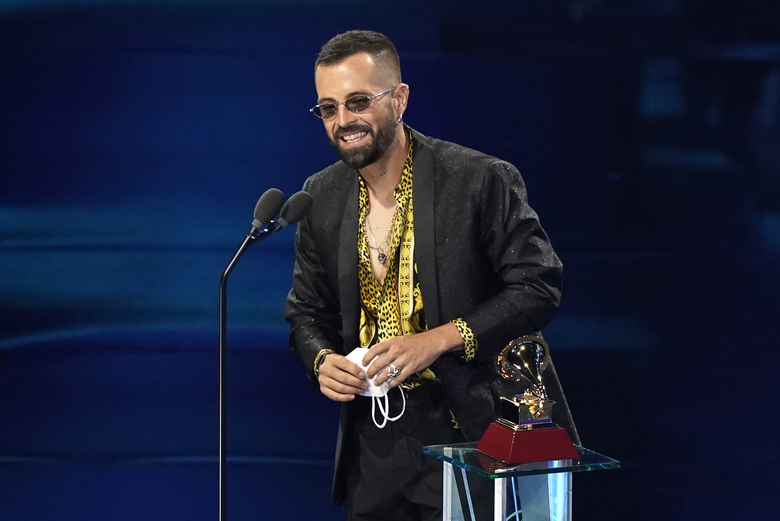 Mike Bahia accepts the award for best new artist at the 21st Latin Grammy Awards, airing on Thursday, Nov. 19, 2020, at American Airlines Arena in Miami. (AP Photo/Marta Lavandier)
